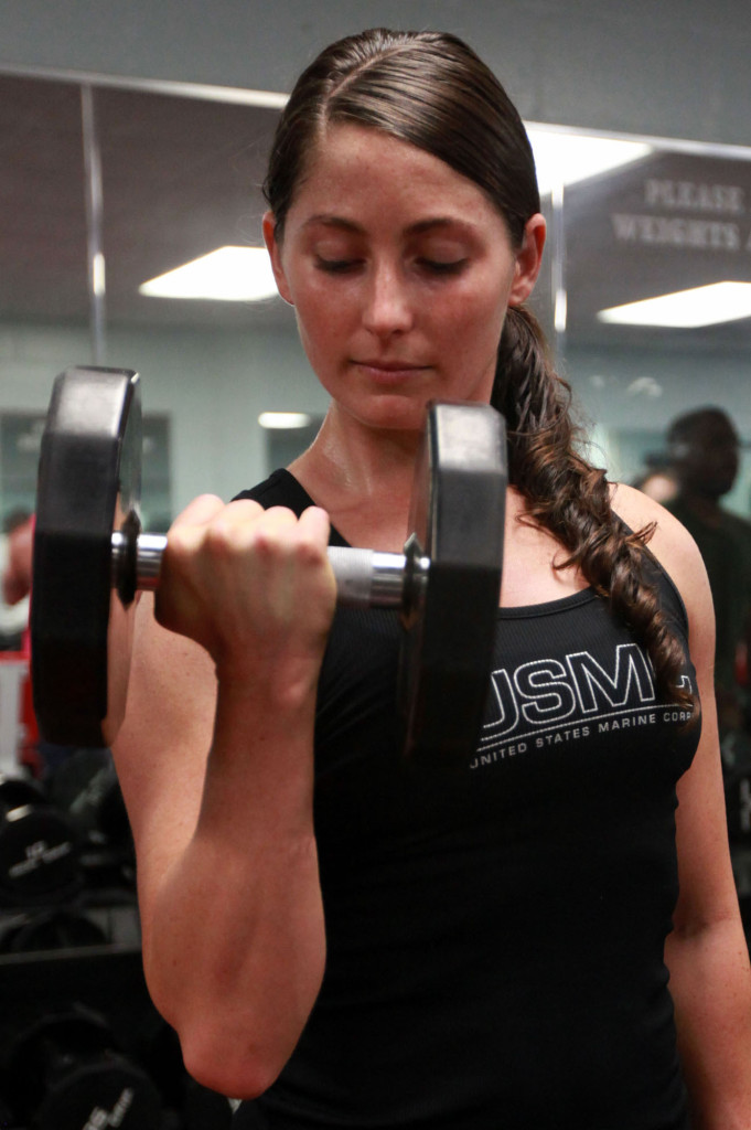 Marine builds strength with weightlifting