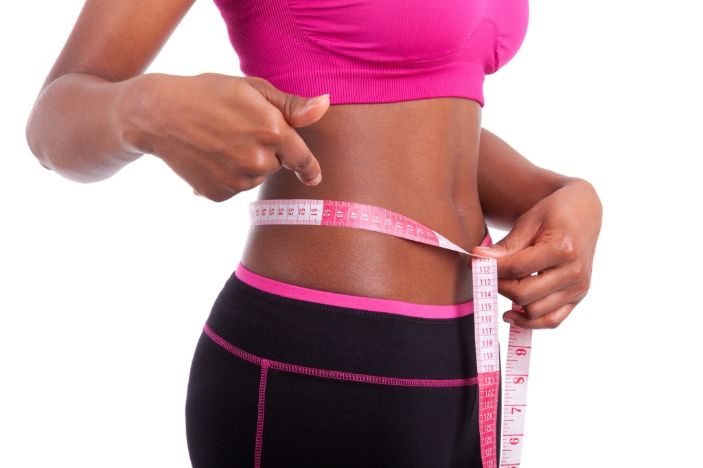 African American Fitness Woman Showing Her Belly